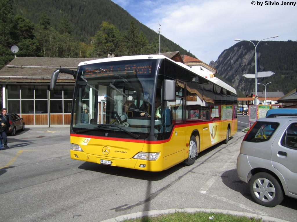 Postauto/Regie Scuol GR 159 302 (Mercedes CitaroII O530LE) am 6.10.2012 in Martina, Cunfin.
