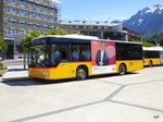 Postauto - Mercedes Citaro  BE  610532 bei den Bushaltestellen vor dem Bahnhof in Interlaken West am 06.05.2016