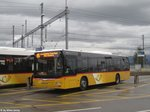 Postauto/PU Schuler SZ 110 235 (MAN A21 Lion's City) am 14.6.2016 beim Bhf.